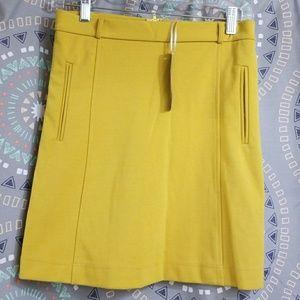 Skirt new mustard  size medium small